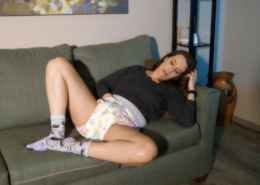 Laying on the sofa, Alisha masturbates in a tabbed, adult-baby style, diaper.