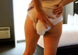 Alisha feels her squishy and soaking wet diaper.